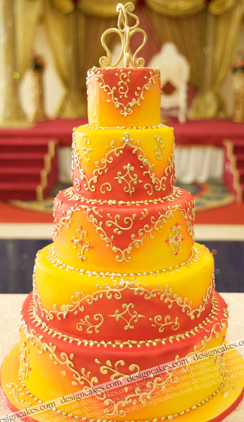 Yellow & Orange non-traditional wedding cake with gold accents ...