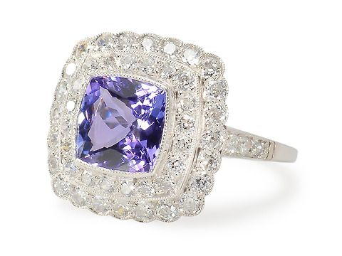 Tiers of Elegance -Tanzanite Diamond Ring. Millegrain bezel set tanzanite surrounded by stepped tier of diamonds and platinum. Diamonds are earlier 20th century, tanzanite and mounting contemporary.  http://www.georgianjewelry.com/items/show/16202-tiers-of-elegance-tanzanite-diamond-ring