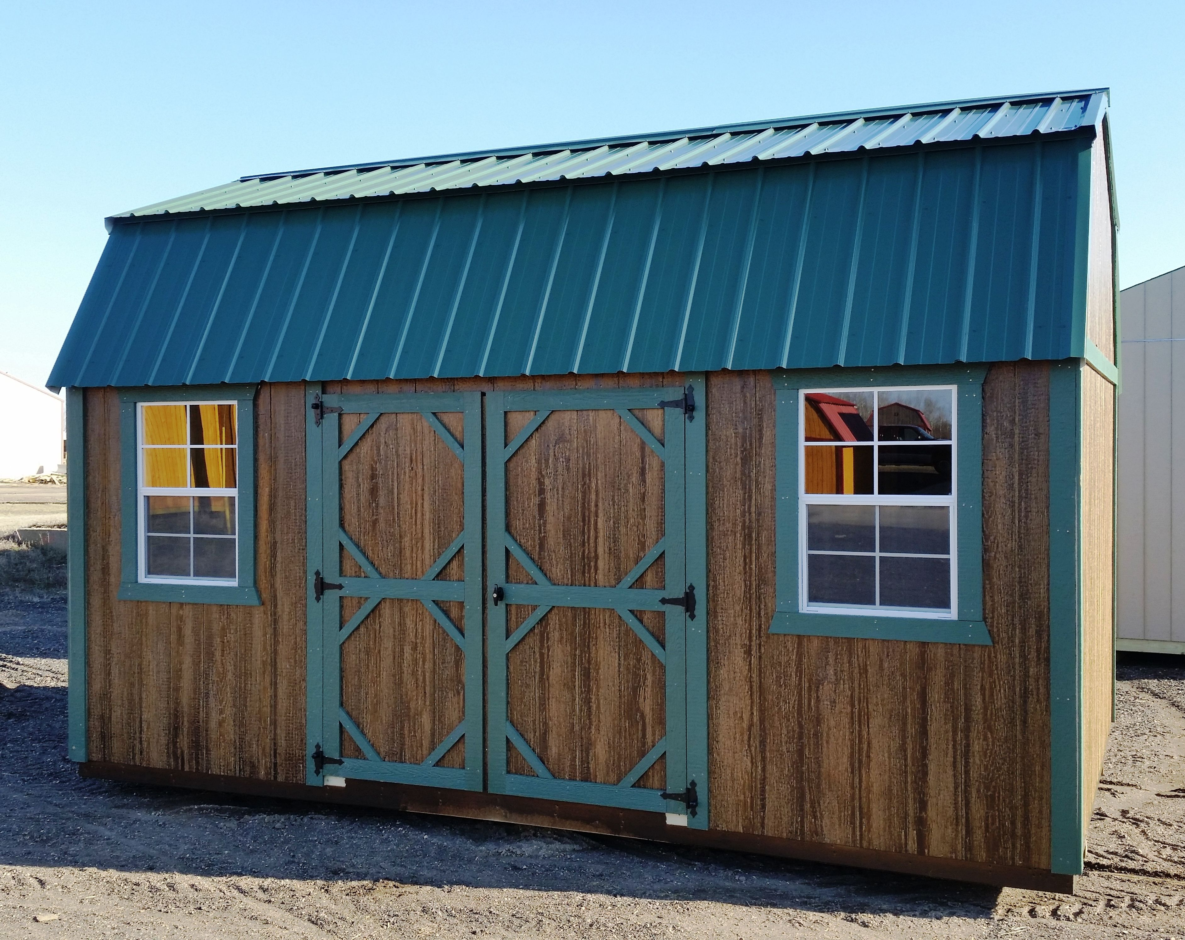 green metal roof with matching trim lp smartside siding stained with haley chestnut double wood doors and 2 windows minnesota made minnesota owned