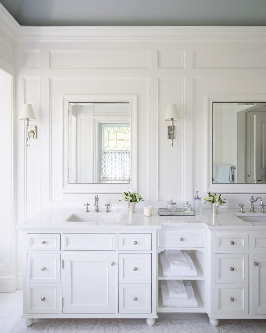 In This Master Bath Beveled Recessed Medicine Cabinets Nestle Into The Tall Paneling Above A Doub White Master Bathroom White Bathroom Designs Bathroom Design [ 1350 x 1080 Pixel ]