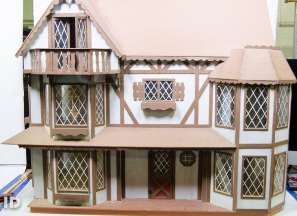 English Tudor Style Dollhouse With Miniature Furniture, Dolls, Fireplace,  Dishes, Rugs And