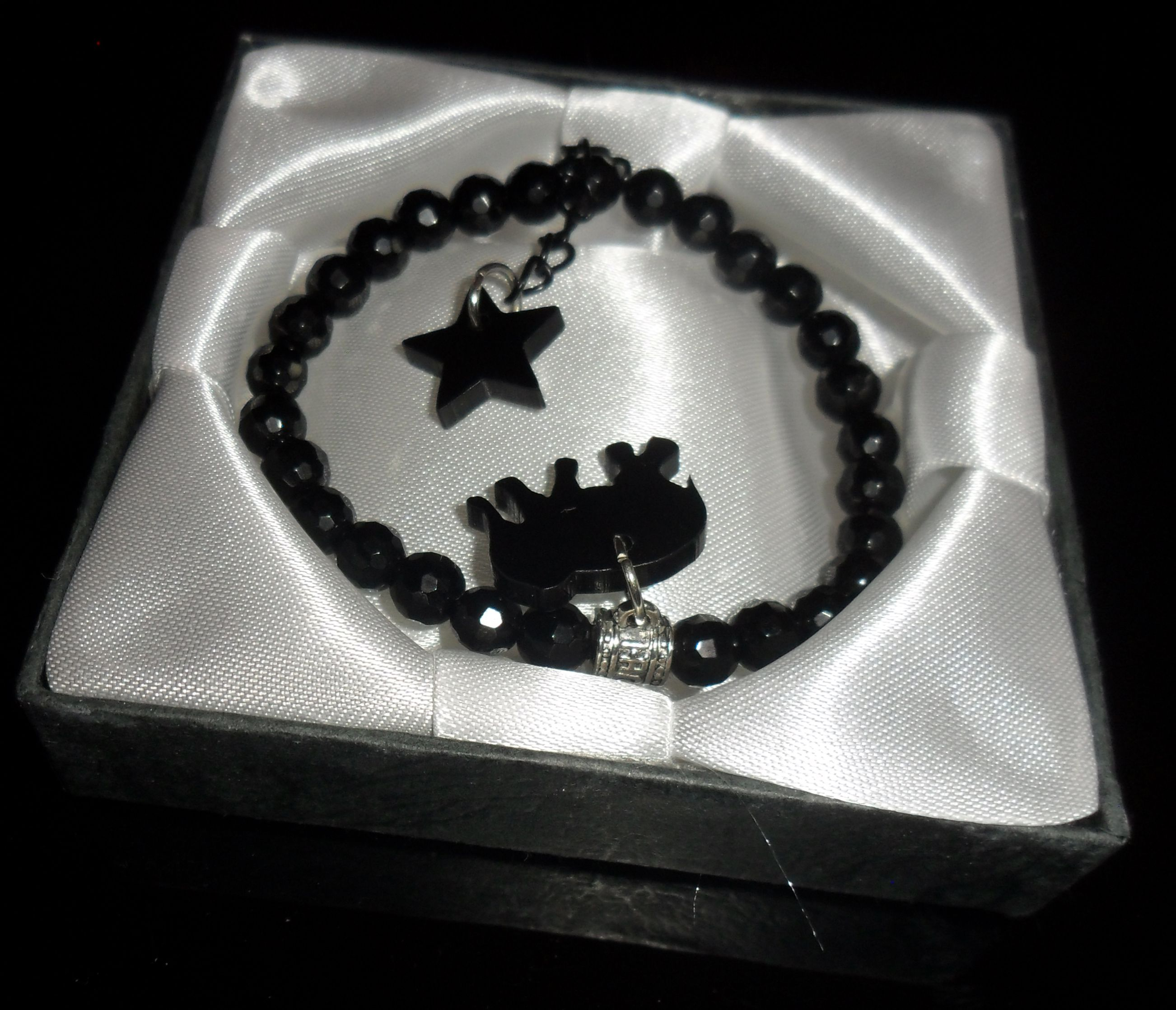 Bracelet made of semiprecious stones black with studs stars and elephant
