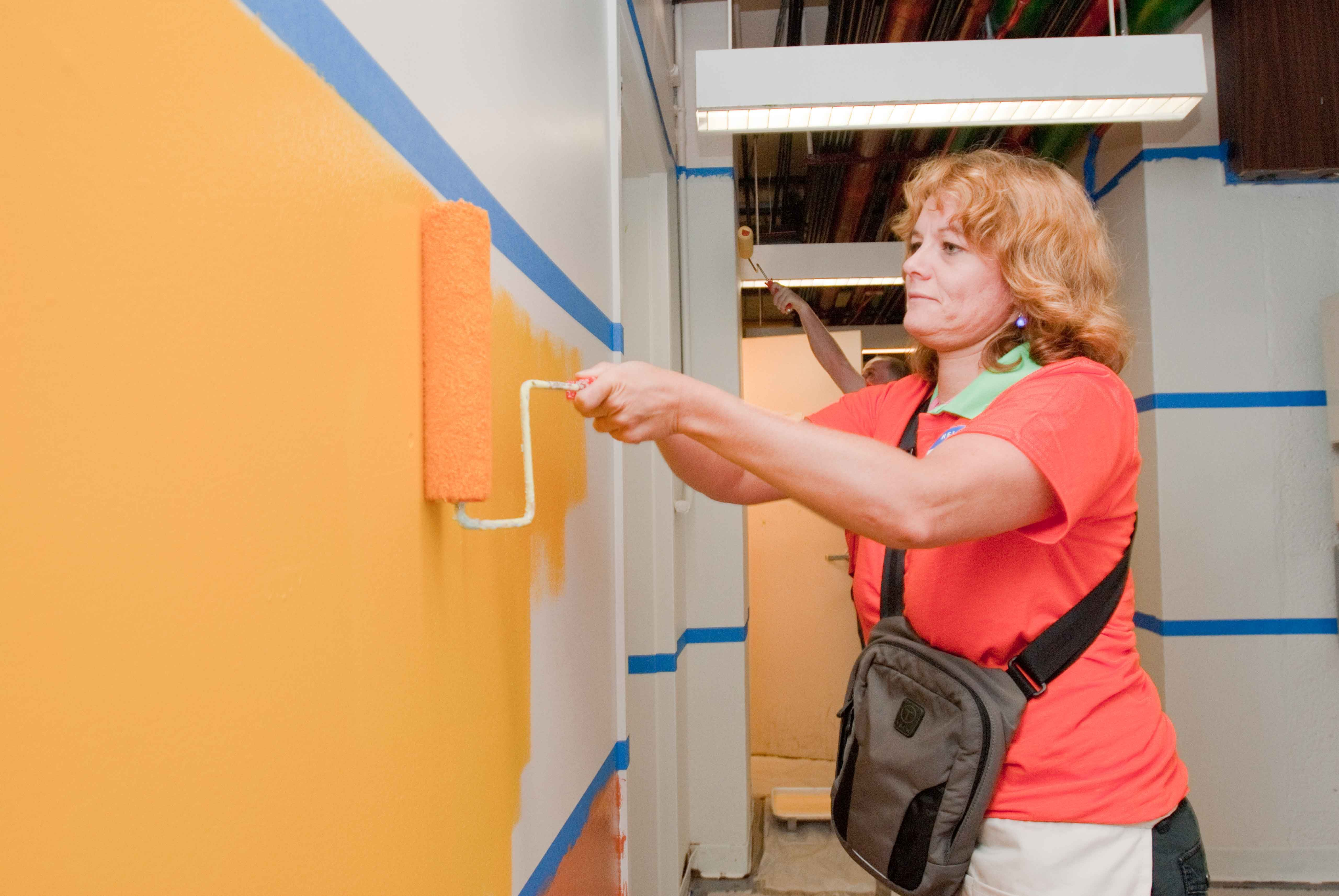 King Towers Community Center gets a fresh coat of paint from many caring volunteers