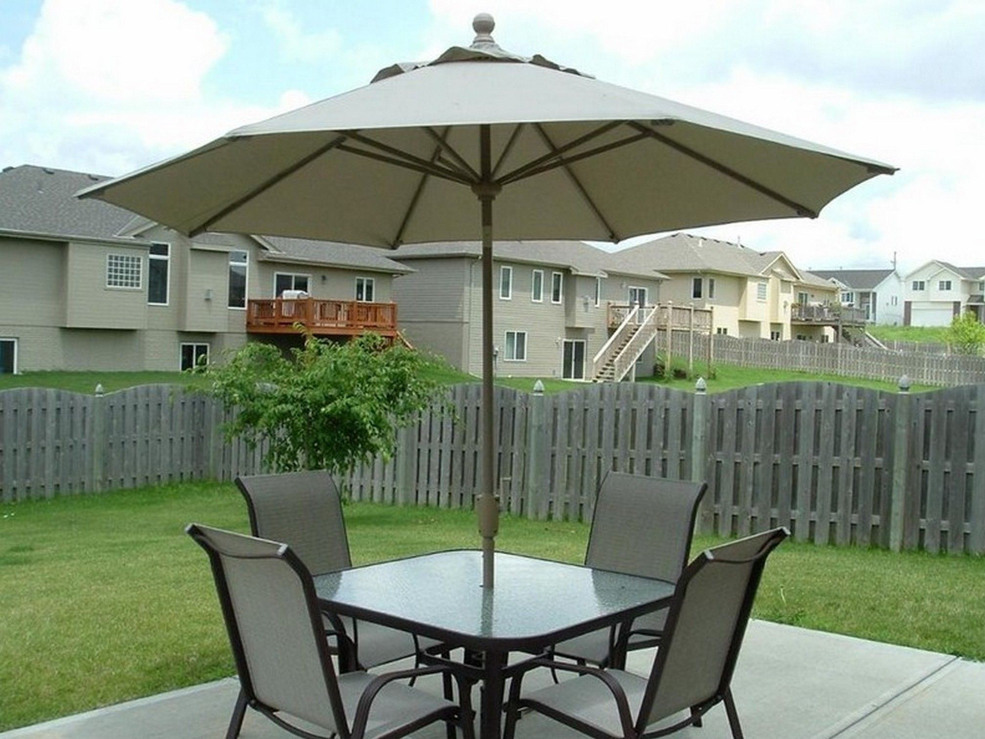 Small Patio Umbrella With Patio Furniture Set And Green Grass Also Fence Jpg 2014 1511 Patio Set With Umbrella Outdoor Patio Set Patio