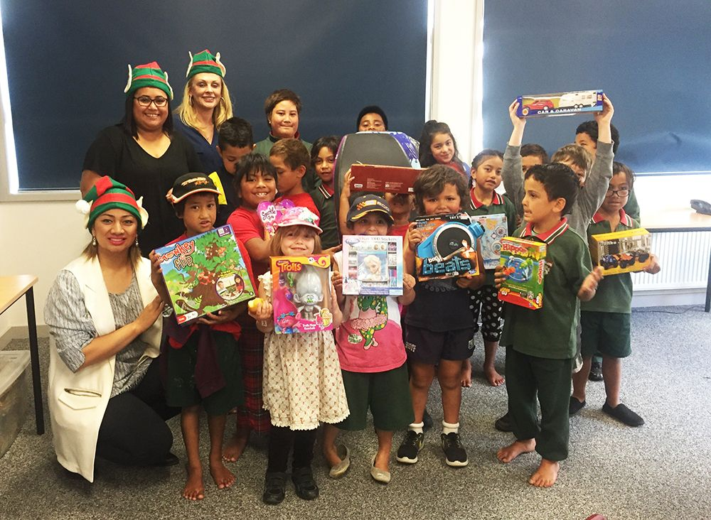 team murray and the city apartments sales team recently raised 1315 towards christmas gifts for less fortunate children in south auckland