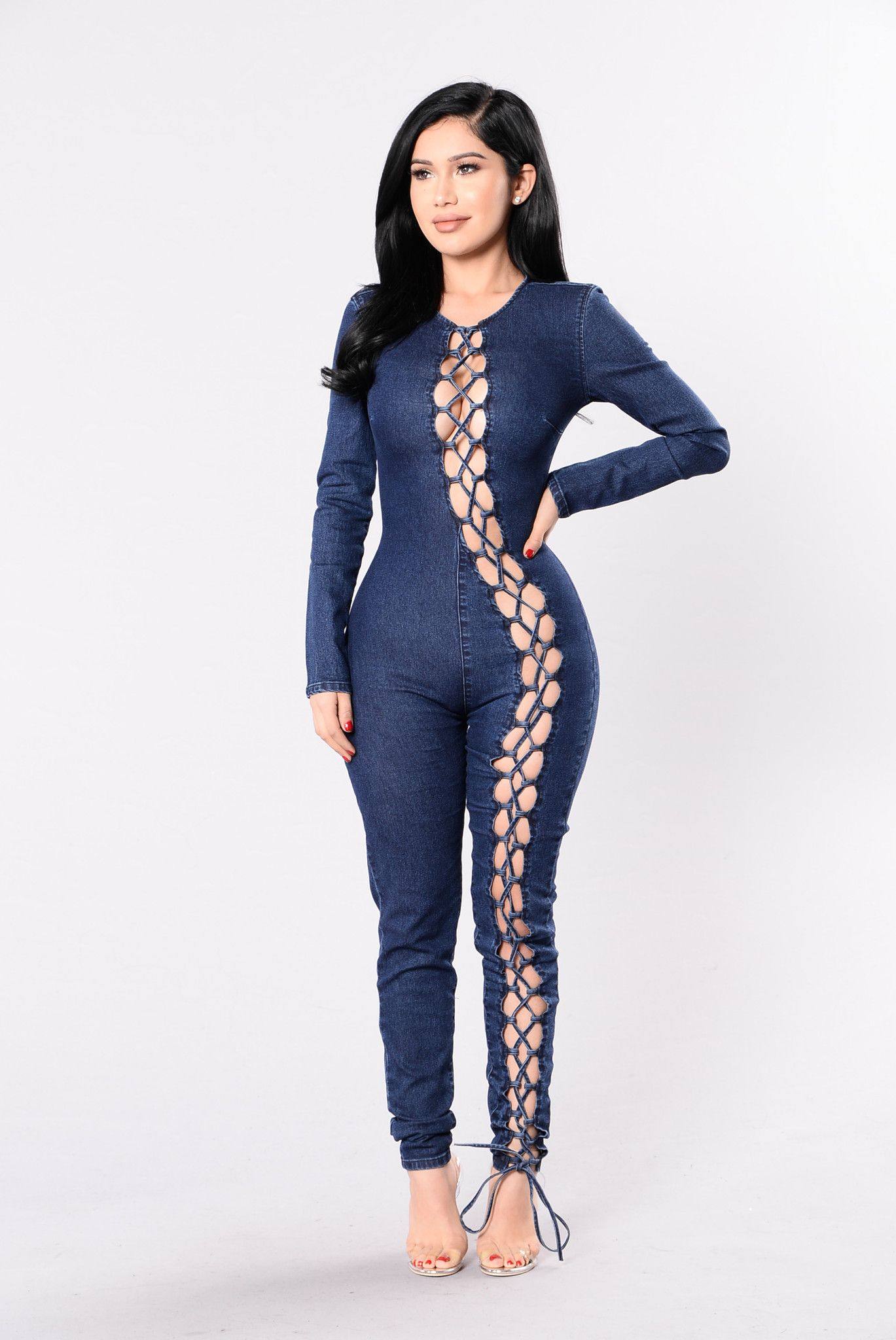 1e6ab7a69707 Available in Blue Stretch Denim Jumpsuit Full Body Lace Up Detail Long  Sleeve Back Zipper Closure 65% Cotton 33% Polyester 2% Spandex