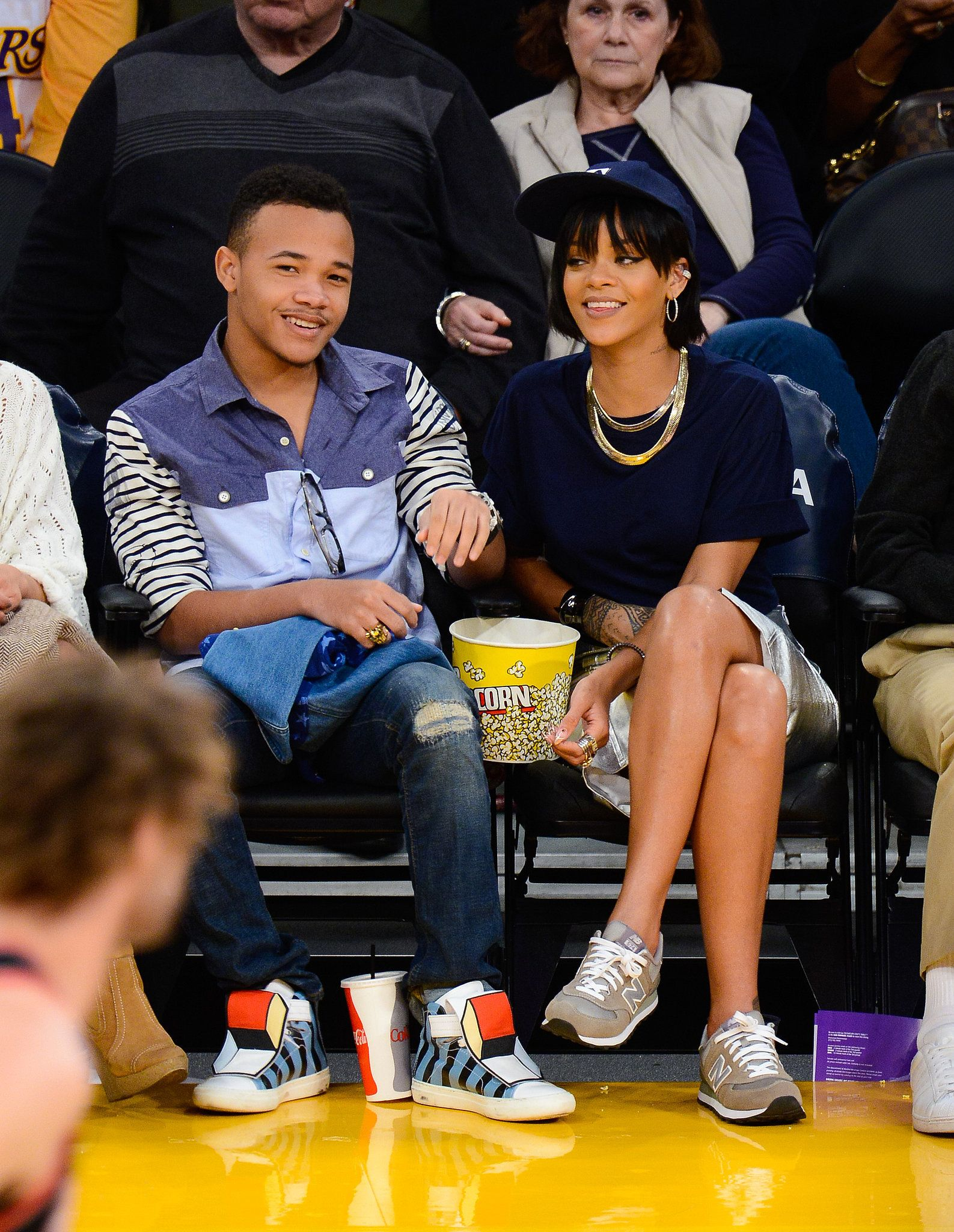 35c88e4fc Stylish outfit ideas for watching a basketball game, courtesy of the stars  (like Rihanna in gray New Balance sneakers and a metallic leather pencil  skirt)