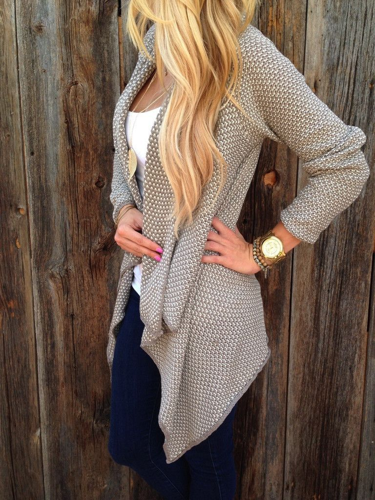 366cd4f3175ccd A two tone knit sweater with a cascading front hem gives a very stylish  look once put it on