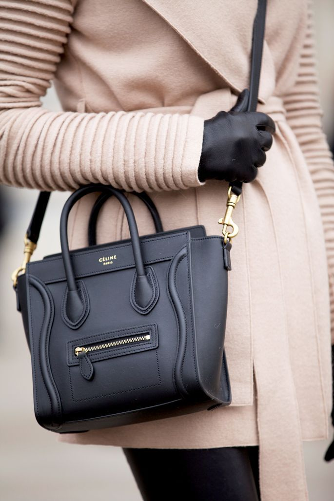 Winter fashion, nude coat with black leather shoulder bag. Fashion,  streetstyle.