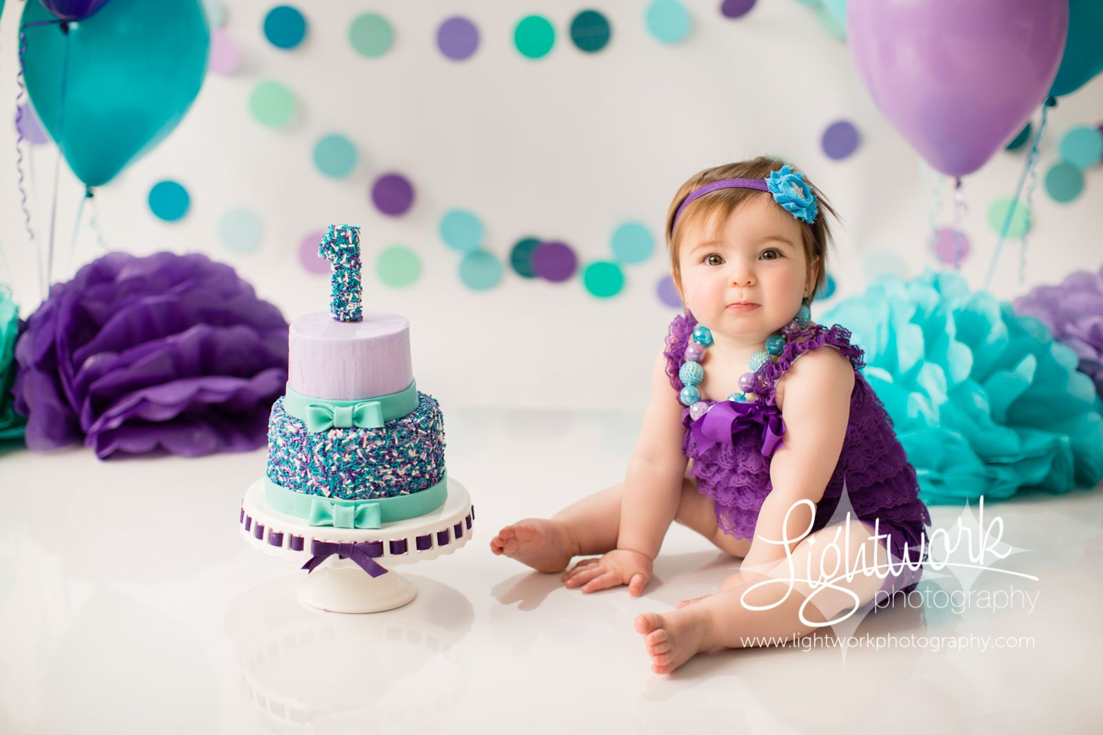 Sprinkles Smash Cake! Cake Smash First Birthday Photo by Lightwork Photography, Cake by Jen of Lightwork Photography, teal aqua turquoise purple lavender, custom jimmies by SimplyBakingSupplies on Etsy, sprinkle 1 topper, tissue flowers, poufs, circle garland, balloons