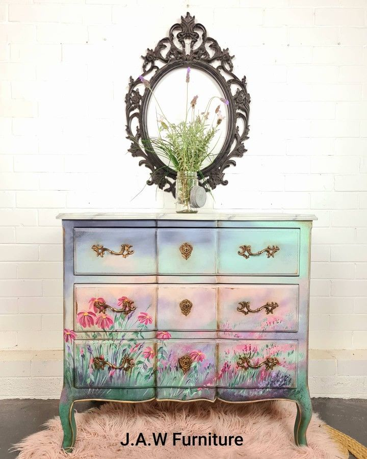 Handpainted floral french style chest of drawers with a faux handpainted marble top. I wanted this piece to have a feeling of freedom, as if you were running through and endless field of blooms. #dixiebellepaint #dixiebellepaintcompany #artist #furnitureartist #furnituremakeover #paintedfurniture #furnitureart #paint #chalkpaintedfurniture #colormovement #upcycle #wildflowers #handpainted #handpaintedfurniture #upcycledfurniture #brisbaneartist #australianartist #jawfurniture