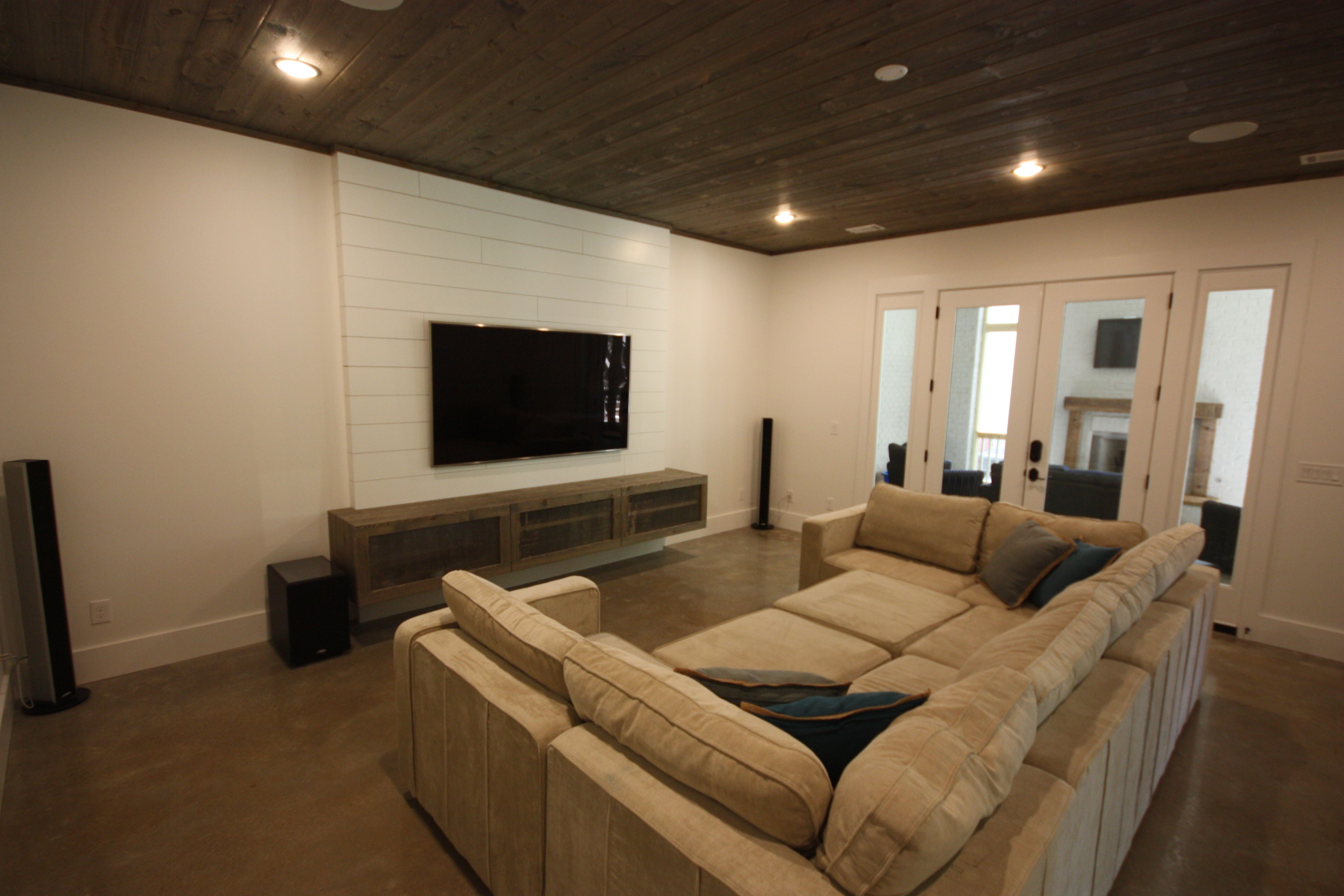 Shiplap TV Wall. Floating Media Stand. Polished Concrete Floors ...