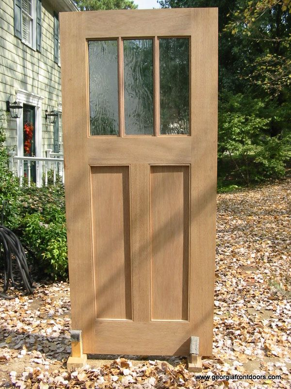 Charmant Craftsman Door With Wavy Glass Insets.