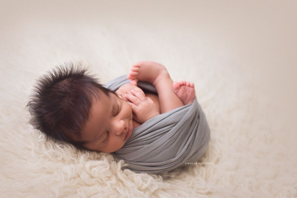 Toronto newborn photographer baby on flokati jd vintage props megan battersby photography