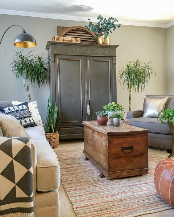 A black armoire is the focal point in this cozy living room