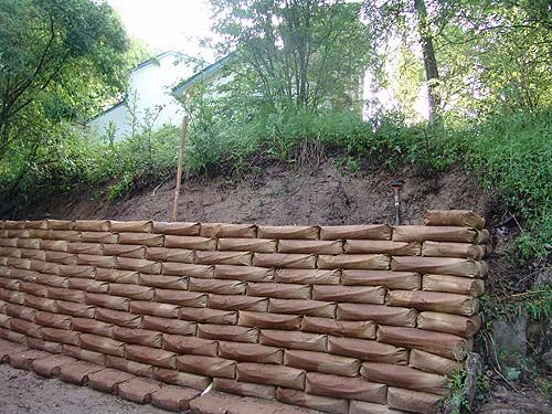 Bags Used As Front Yard Retaining Wall Concrete Retaining