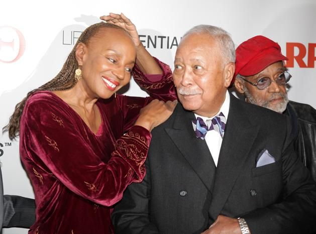 Susan L. Taylor and former New York City Mayor David Dinkins enjoy a moment during Ruby Dee's 90th birthday.