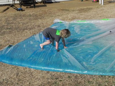 use a tarp, duct tape the seams (lasted 45 mts, not reinforced - extra duct tape would last longer), fill with hose water and blue food coloring.  Its like a giant sensory mat/squishy bag/waterbed all in one.  I had intended on adding things to the water....like fish or balls, but we got so caught up in the fun that I totally forgot.