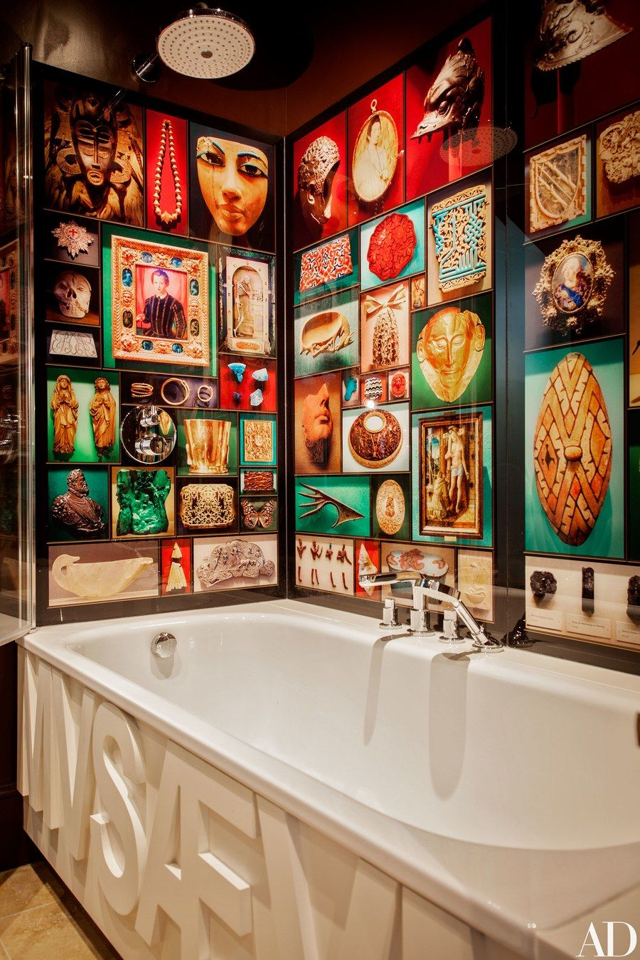 Ashley's snapshots of museum treasures turn the bath into a cabinet of curiosities. Bette tub; Hansgrohe fittings.