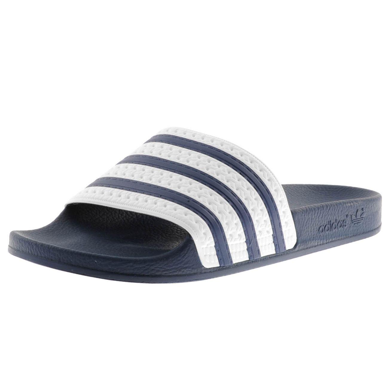 c0e0fdf28d719d Adidas Originals Adilette Slides Flip Flops In Adiblue Navy. Be Original  even at the pool!