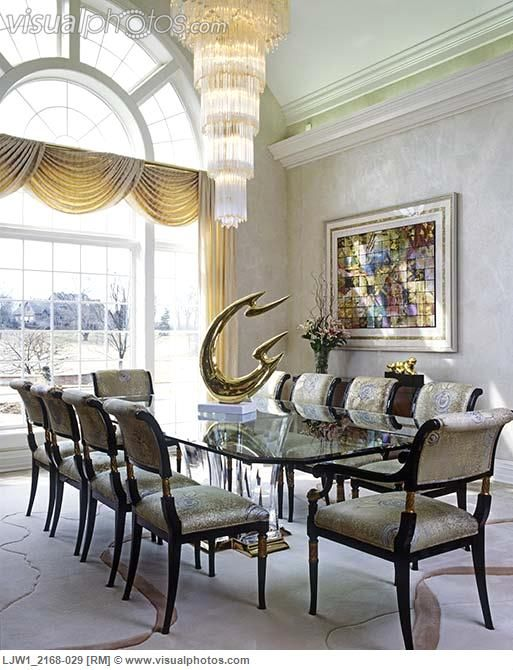 DINING ROOM Modern Tiered Chandelier Glass Table Sculpture On Formal Swag Drapes Over Large 1 Story Window Palladian Vaulted Ceiling Indirect