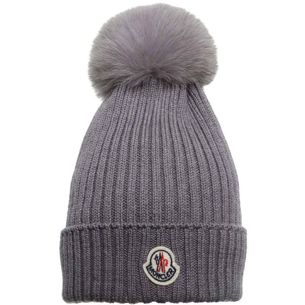 e76394ba6 Unisex grey, wool chunky knit hat by Moncler with a large real fur ...