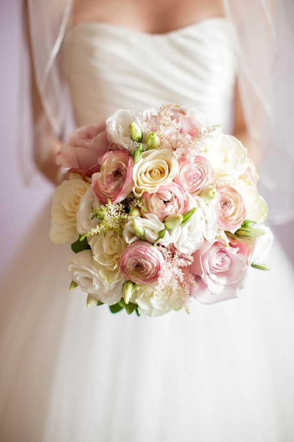 spring bouquet with roses, ranunculi, and astilbe