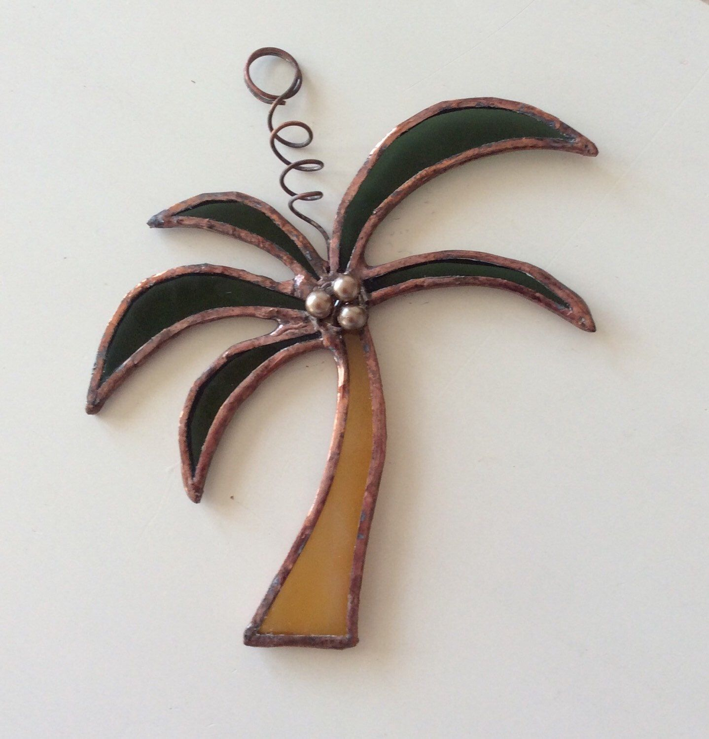 A personal favorite from my Etsy shop https://www.etsy.com/listing/236639920/stained-glass-palm-tree