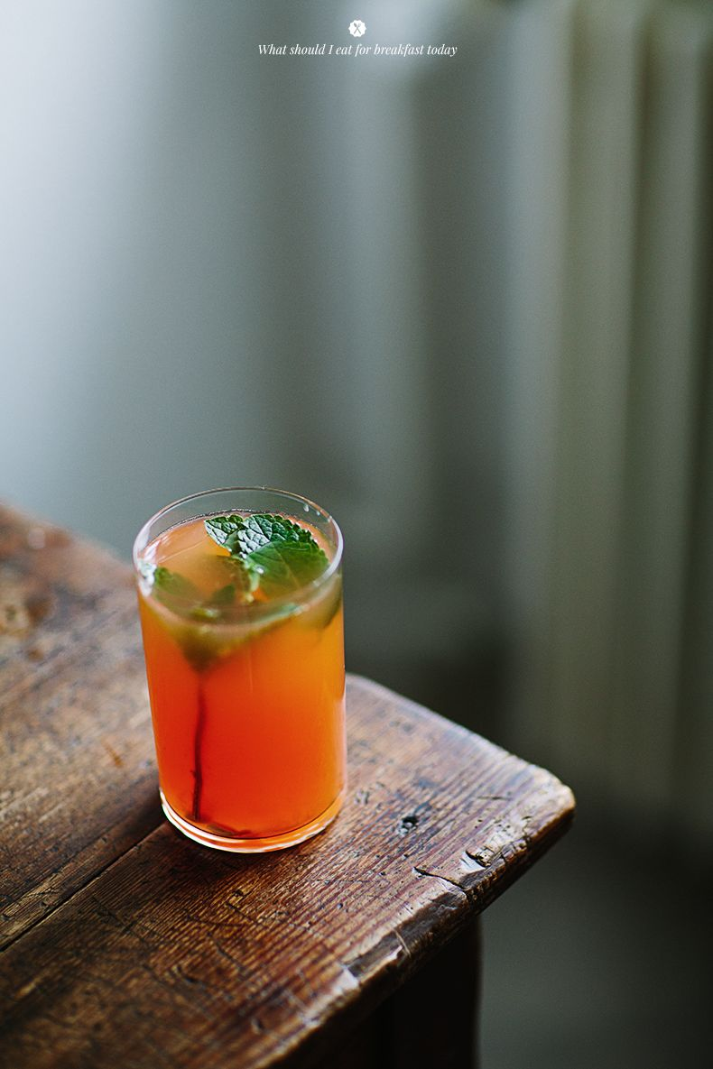 Drink with Rhubarb syrup, sparkling water, orange and mint