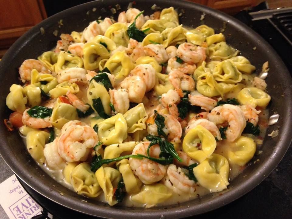 Sauteed Shrimp and spinach, with tomato & tortellini - yum.  Sauce also included garlic, lemon, white wine.