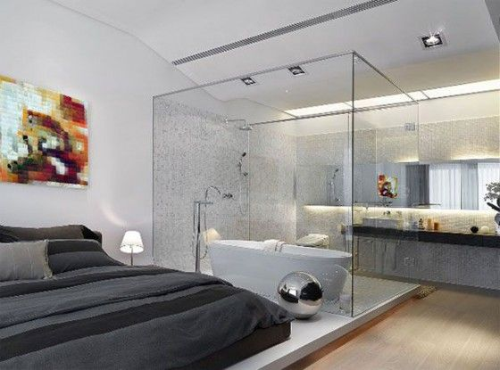 A Contemporary Bedroom With An Attached Glass Bathroom And Whats More Jacuzzi Too