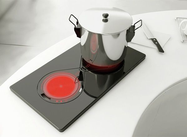 Two any One - Portable Electric Oven with Built - In Charging System by Kim Yo Hwan is a functional induction cooker. Made up of cooking plates that detach and fold up for easy portability. No cords needed due to the built-in charging mechanism.#portable #stove #YankoDesign
