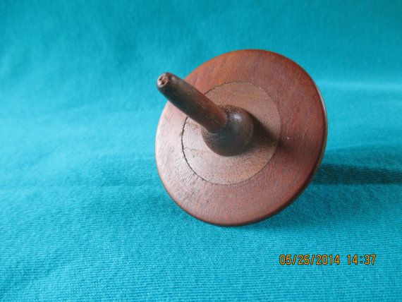 Wooden spinning wood top by SDIWoodworking on Etsy, $5.00