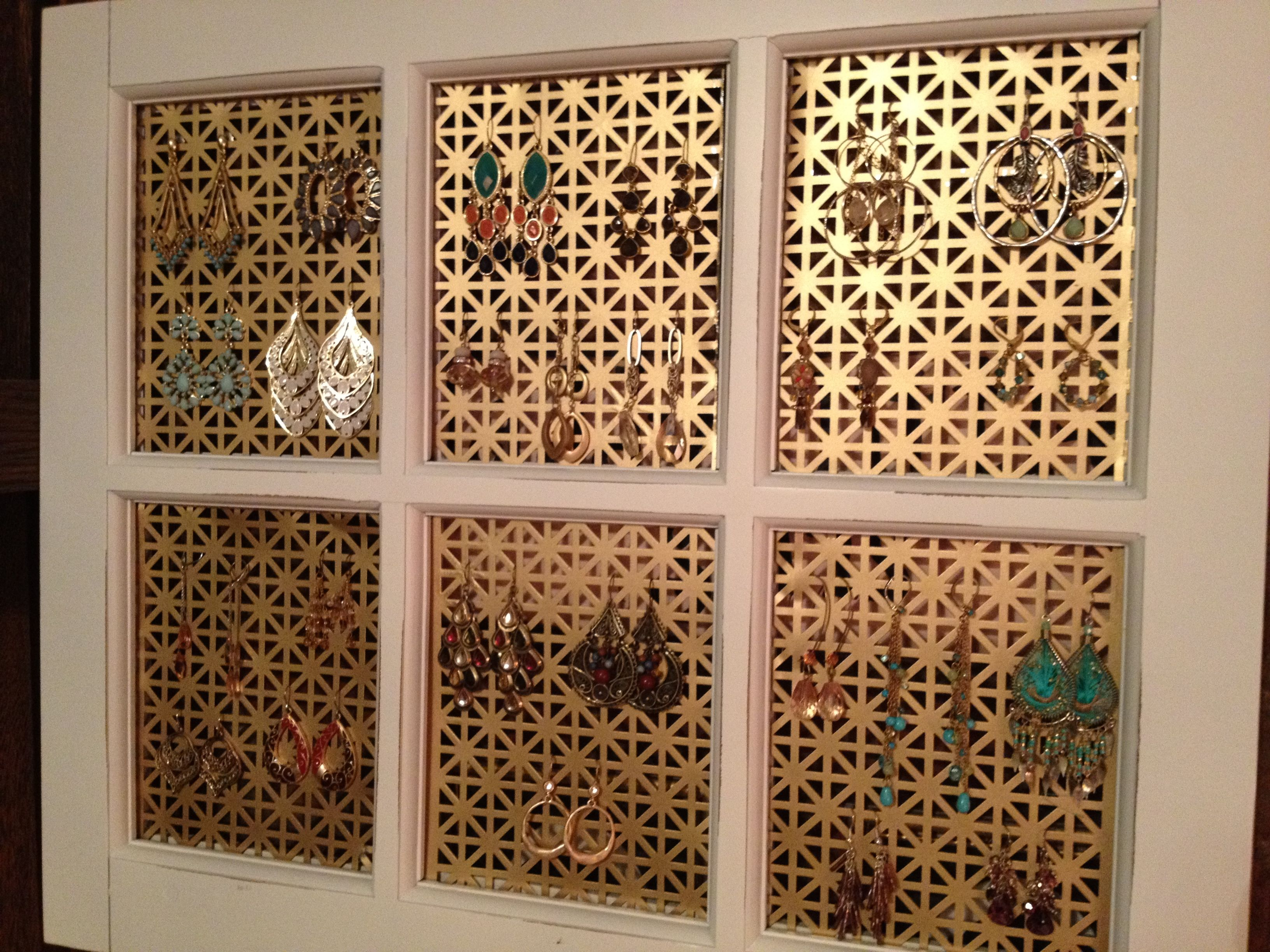 DIY earring holder! Take any picture frame, remove the glass and ...