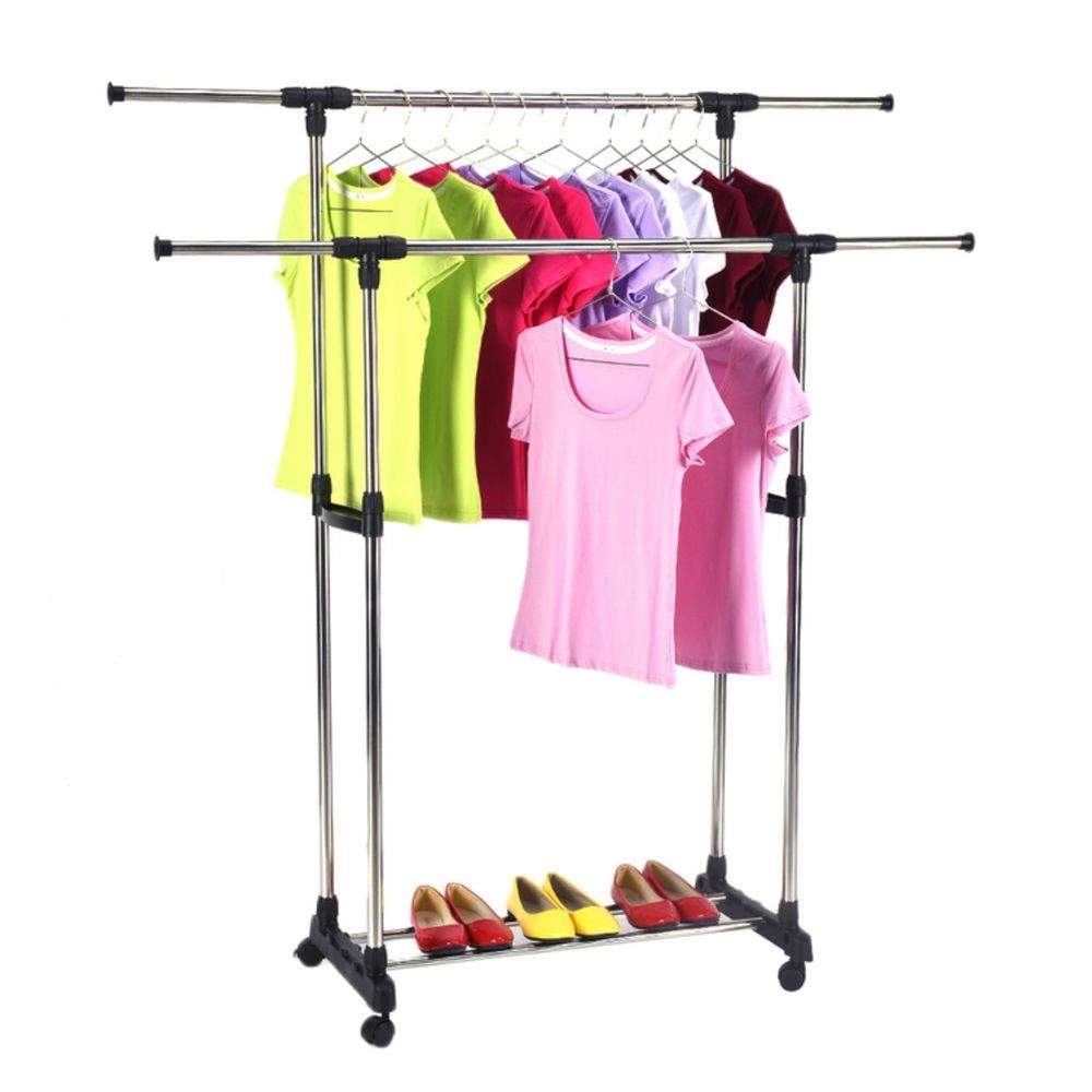 Portable rolling clothing rack on wheels holds rows of garments