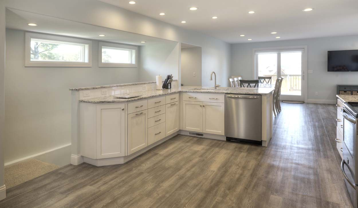A Wide Open Kitchen In Traverse City Michigan Was Designed By Angela Goodall At Kitchen Choreography Angela Used Off White Cabinets Custom Cabinets Cabinetry