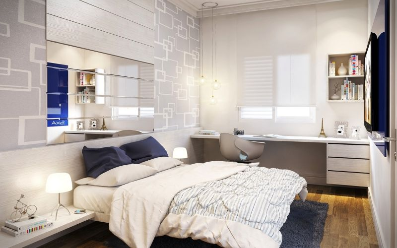Petite chambre adulte avec bureau miroirs et couleurs claires