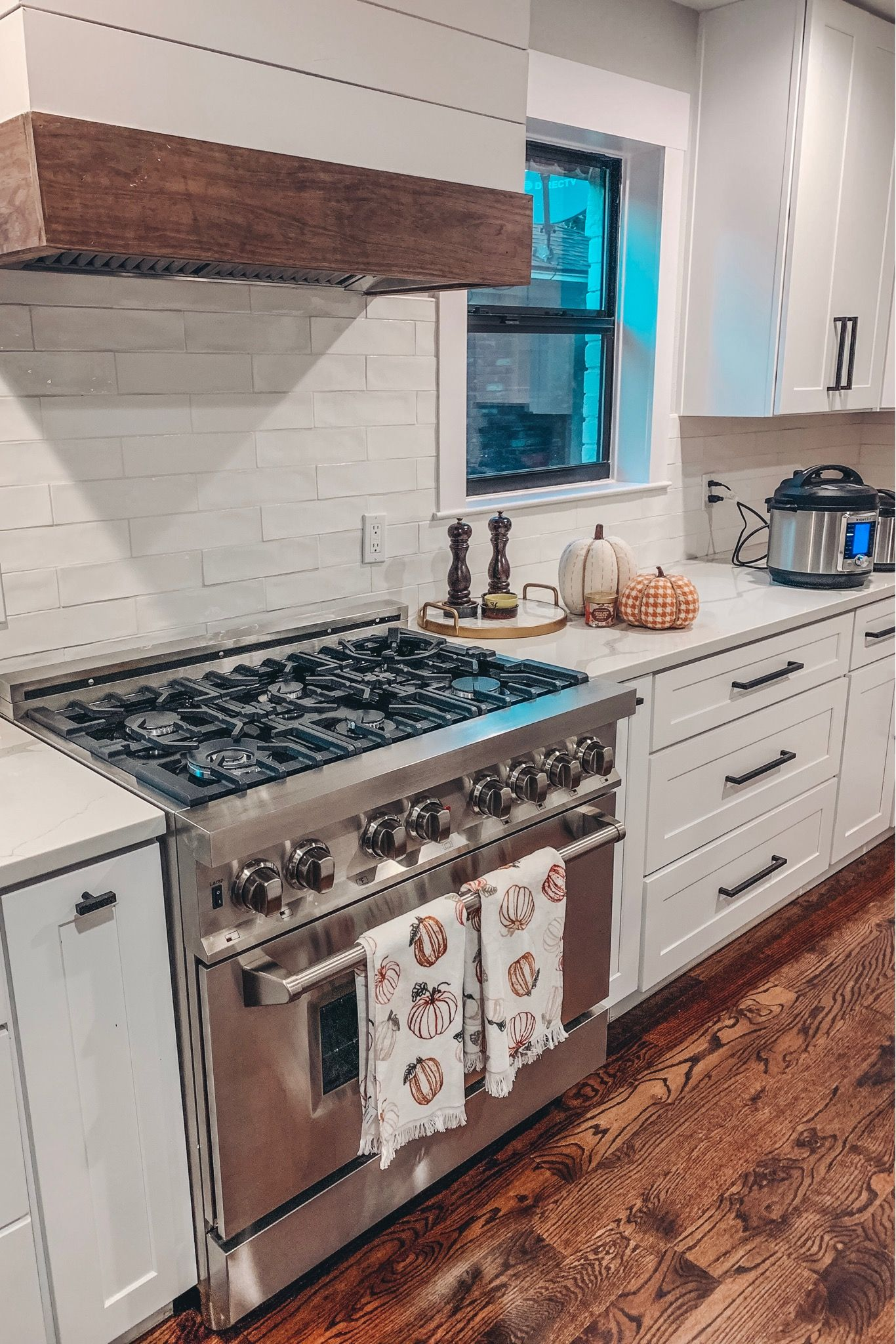 Farmhouse Kitchen With Fall Decor Including Fabric Pumpkins