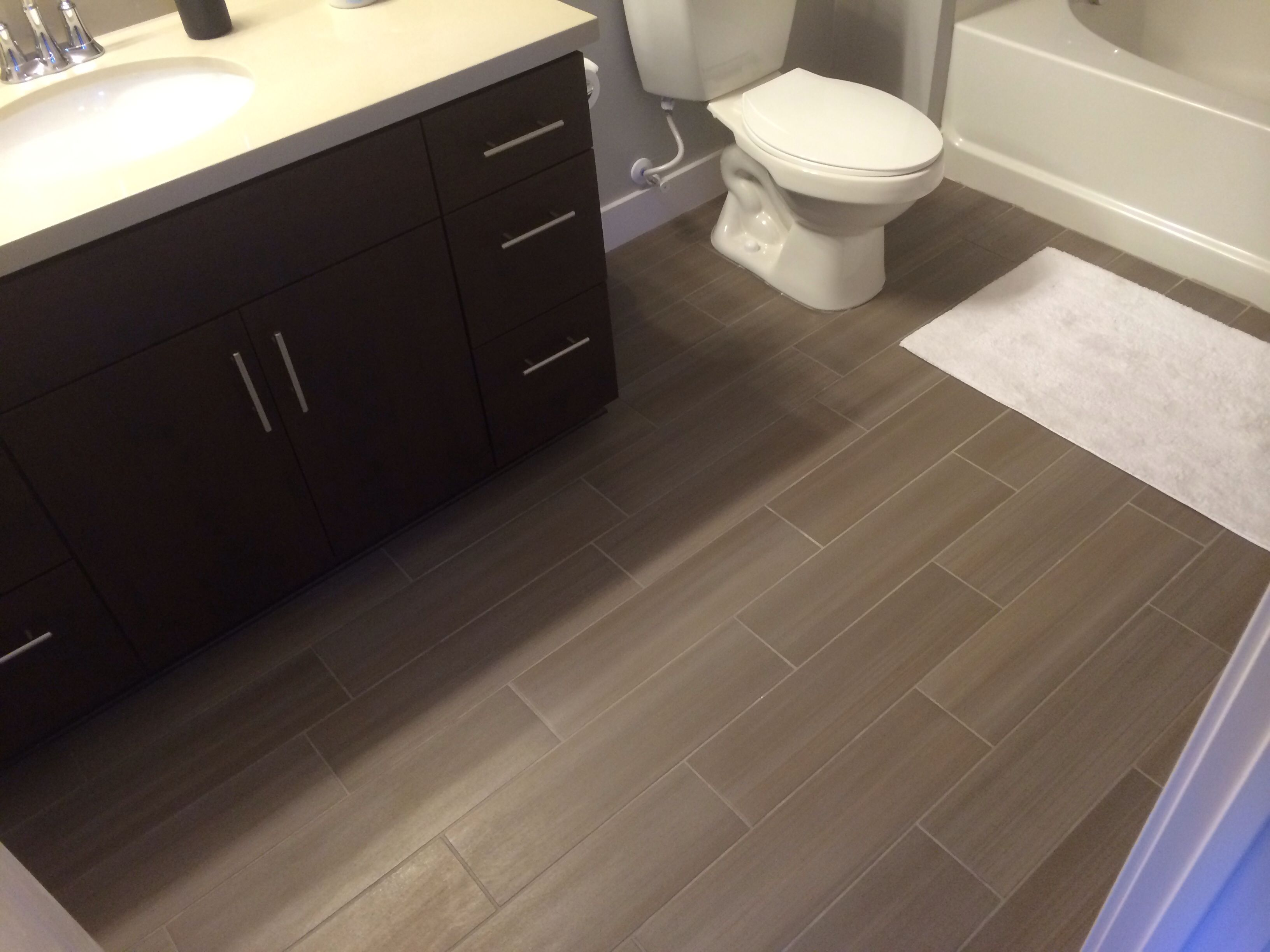 Best 25 bathroom flooring ideas on pinterest bathrooms bathroom floor cabinets and grey Bathroom flooring tile