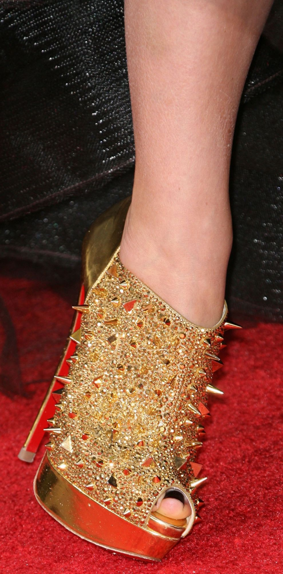 69fd2e324c00ca Olivia Wilde in gold Christian Louboutin  Bridget s Back  ankle boots