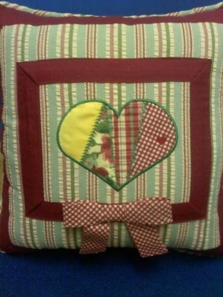 This is a heart toss pillow I use on the couch.  The small living room has a French country decor.