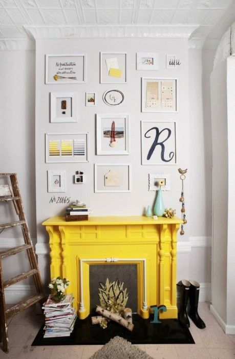 Yellow fireplace and eclectic white-framed gallery wall. | COLOR ...