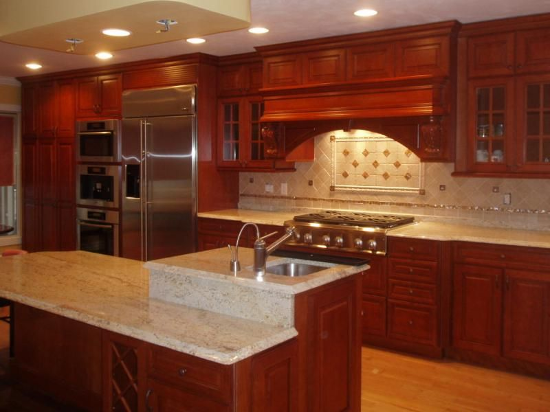 Kitchen Backsplash With Cherry Cabinets ivory backsplash with cherry cabinets |  coffee machine