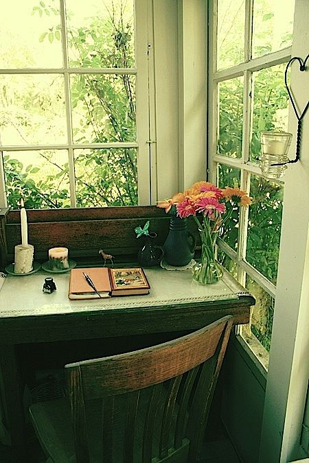 prefect spot for a writing desk, open windows with lots of greenery.