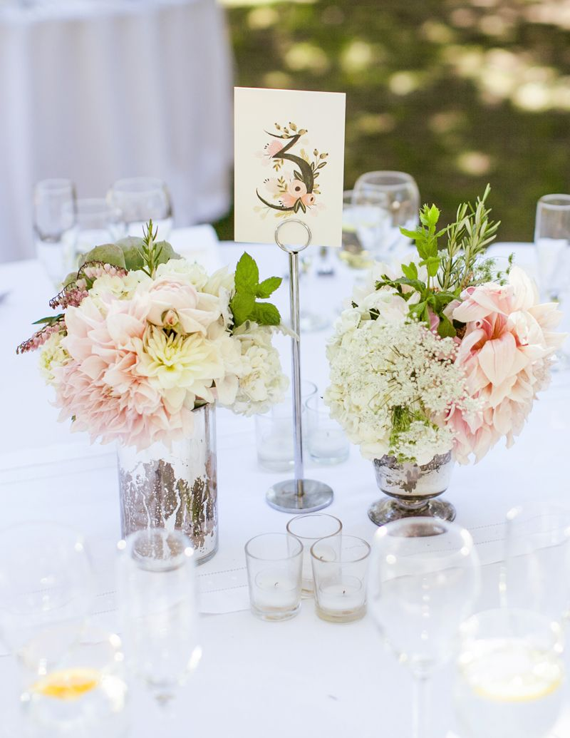 Beautiful matching pink flower table arrangements and table number ...