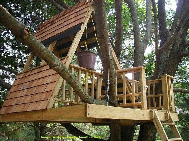 Neat tree house idea!I like the idea of the slanted roof/walls ...
