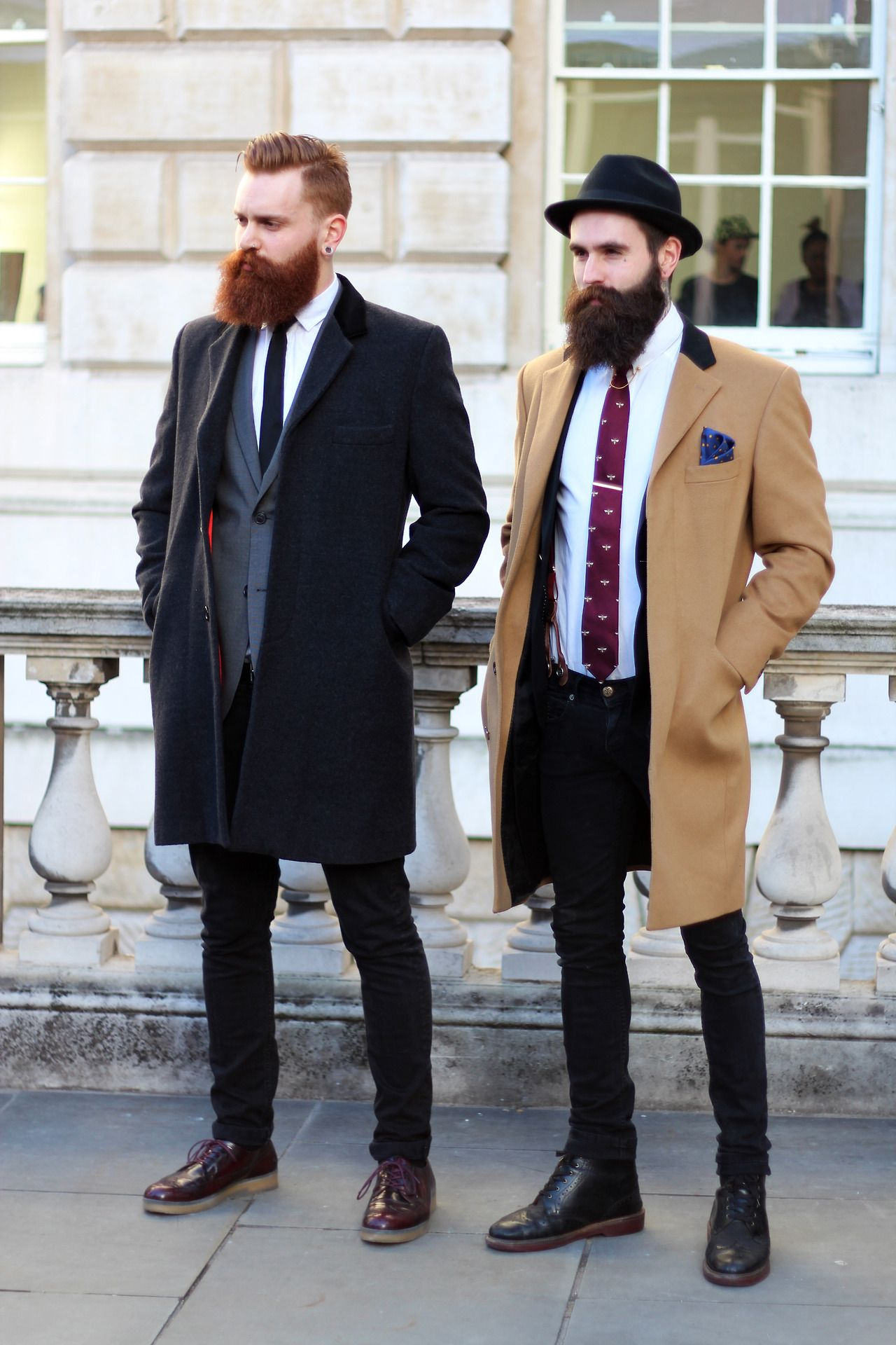 Tie bars are often worn to the full width of the tie now as long as