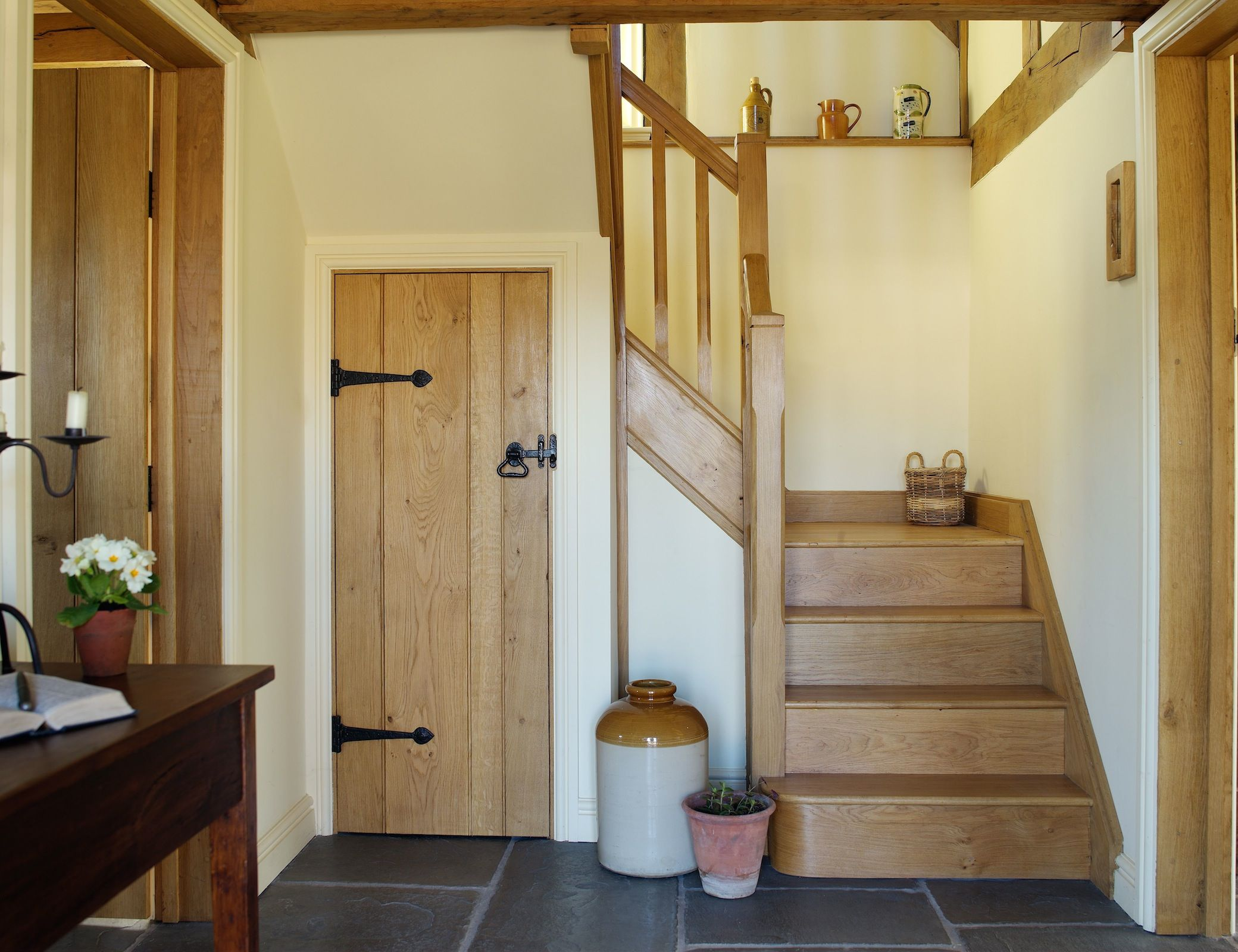 Lighting Basement Washroom Stairs: Open Hallway With Oak Staircase