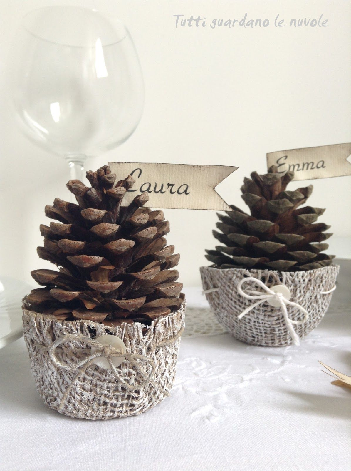 Jute basketsfor pine cones. Crop to fit, starch with food starch.Dry on upside down bowls.Decorate simply with a drawstring and button.