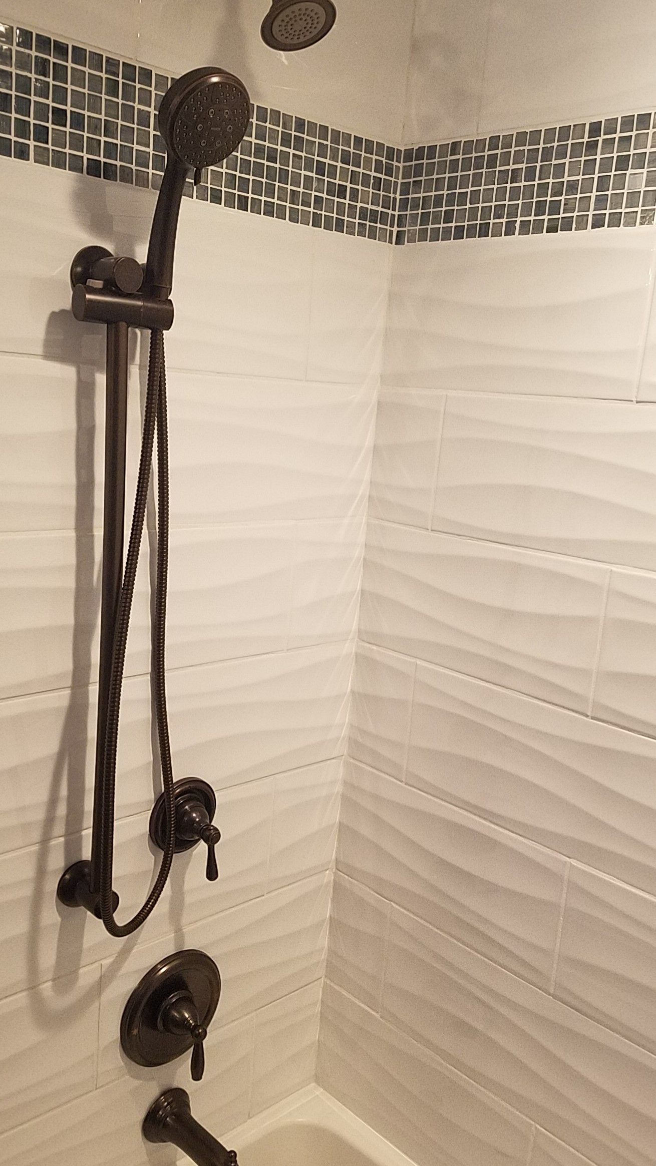 Large Wave Subway Tile In The Shower Area Adds Texture To